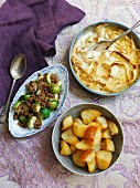 Parsnip gratin with Brussels Sprouts, chestnut crumbles and roast potatoes