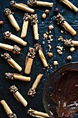 Homemade tuille biscuits with in chocolate and nuts (seen from above)