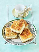 Slices of Bienenstich (caramelised almond cake) on a plate