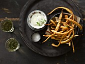 Fried parsnip with salt and pepper served with aioli and white wine