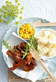 Spicy marinated steak strips with potatoes and sweetcorn