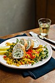 Turkey and herb roulade on a bed of couscous