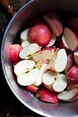 Halved apples in a metal bowl
