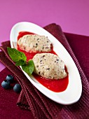 Blueberry and yogurt jelly with raspberry sauce