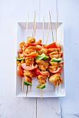 Raw chicken and pepper skewers marinated in honey and curry