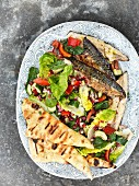 Oriental salad with grilled mackerel and unleavened bread