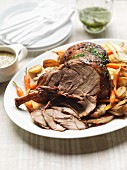 Roast lamb with root vegetables and a mint and caper sauce