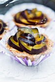 Plum tartlets in paper cases