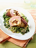 Stuffed veal roulade with a green kale medley