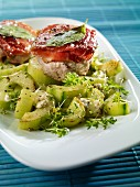 Fried pork fillet with sage and a cress-cucumber salad