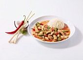 Red chicken curry with rice (China)