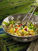 White cabbage salad with apples and oranges