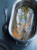 Poached trout in vegetable broth