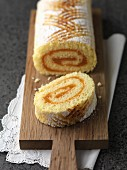 Swiss roll with apricot jam, sliced