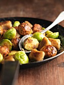 Gnocchi with chestnuts and Brussels sprouts in a pan