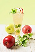 Apple juice with mint and fresh apples