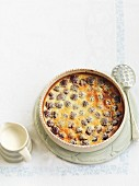 Clafoutis in a round baking dish