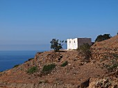 A whitewashed ruin on the Mediterranean coast near Tetouan, Morocco