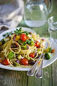 Spaghetti with vegetables, turmeric and marjoram
