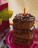 A stack of chocolate cake slices for a birthday