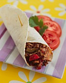 A beef wrap with peppers