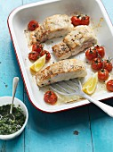 Oven-baked hake and cherry tomatoes with cucumber salsa