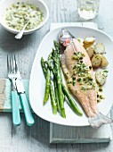 Poached trout with a caper sauce and green asparagus