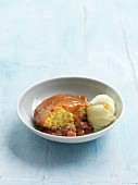 Sponge cake with caramel sauce, rhubarb and vanilla ice cream