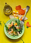 Rocket salad with mandarins, olive oil and balsamic cream