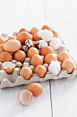 Chicken's eggs and quail's eggs in an egg box