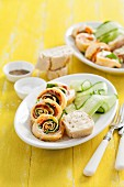 Pancake rolls with salmon, spinach and goat's cheese served with cucumber strips