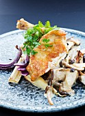 Guinea fowl with a mushroom sauce and roasted root vegetables