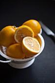 Fresh lemons in an enamel sieve