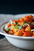 Potato curry with chilli peppers and spring onions