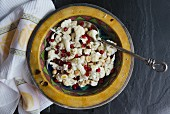 Cauliflower salad with pomegranate seeds and hazelnuts