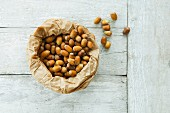 A paper bag of hazelnuts (seen from above)