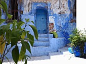 The entrance to a house in one of the blue alleyways of Chefchaouen, Morocco