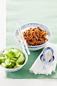 Stir-fried strips of beef with ginger, soy sauce and sake served with a cucumber salad