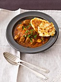Beef goulash with corn cakes