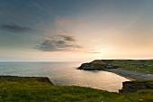 The coastline of Gunwalloe at sunset (Cornwall, England)