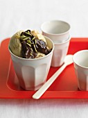 Vanilla ice cream with chocolate and coffee sauce and pistachios