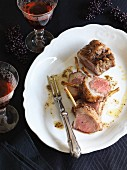 Roast saddle of lamb with spiced butter