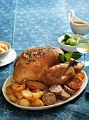 Roast turkey with a chestnut and sage stuffing served with roast potatoes and Brussels sprouts