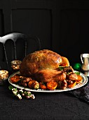 Festive roast turkey with a herb and pistachio stuffing and side dishes