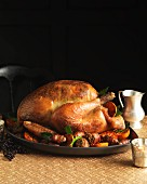 A festive roast turkey with a herb and pistachio filling and side dishes
