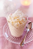 Coconut mousse decorated with silver pearls for Christmas
