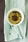 A bowl of jasmine tea on Japanese paper