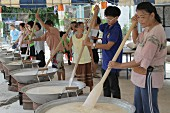 Thai people cooking sweet rice