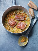 Chickpea stew with hake in bacon
