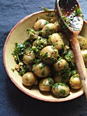 Cooked, unpeeled potatoes with parsley